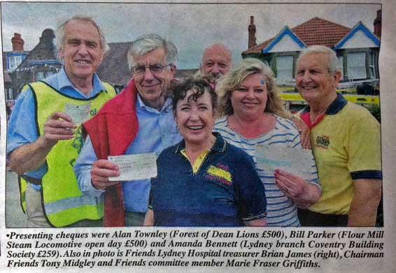 A photo of Lions presenting a cheque for £500 to the Friends of Lydney Hospital at the annual Fete.
