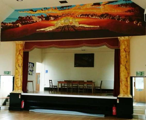 A photo of Broadwell Memorial Hall with the new muralA